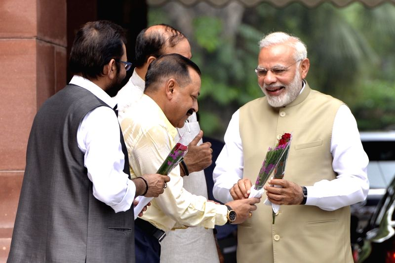 Prime Minister Narendra Modi being greeted by Union Ministers Ananth Kumar, Mukhtar Abbas Naqvi and Jitendra Singh, on his arrival at Parliament in New Delhi, on July 17, 2017. - Narendra Modi, Ministers Ananth Kumar, Mukhtar Abbas Naqvi and Jitendra Singh