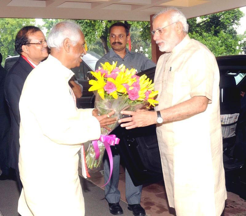 Prime Minister Narendra Modi being received by the Minister of State for Labour and Employment (Independent Charge), Bandaru Dattatreya, on his arrival for the 46th Indian Labour ... - Narendra Modi