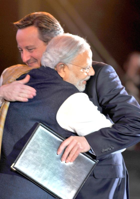 Prime Minister Narendra Modi being received by the Prime Minister of United Kingdom (UK), David Cameroon at Wembley Stadium, in London on Nov 13, 2015. - Narendra Modi