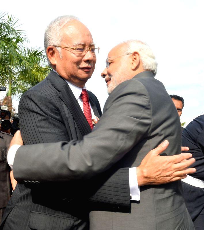 Prime Minister Narendra Modi being received by the Prime Minister of Malaysia Najib Razak, in Putrajaya, Malaysia on Nov 23, 2015. - Narendra Modi