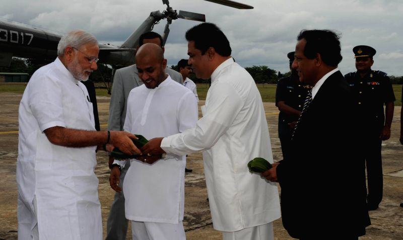 Prime Minister Narendra Modi being received on his arrival at Anuradhapura, Sri Lanka on March 14, 2015. - Narendra Modi