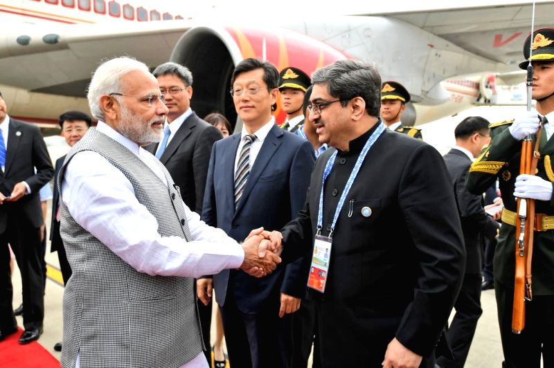 Prime Minister Narendra Modi being received on his arrival for the Shanghai Cooperation Organisation (SCO) summit in Qingdao, China on June 9, 2018. - Narendra Modi