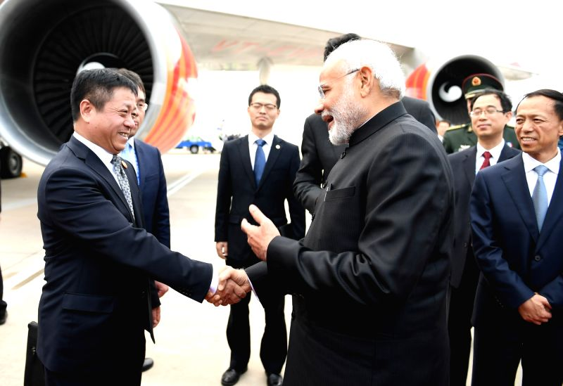 Prime Minister Narendra Modi being seen off as he departs for India after attending the Shanghai Cooperation Organisation (SCO) Summit from Qingdao, China on June 10, 2018. - Narendra Modi