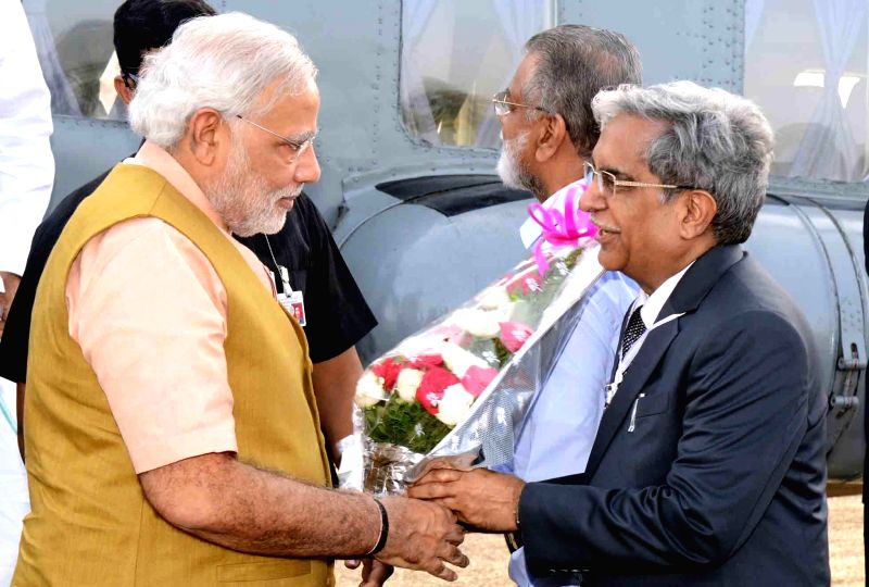 Prime Minister Narendra Modi being welcomed after his arrival at Sriharikota of Andhra Pradesh on June 29, 2014. - Narendra Modi