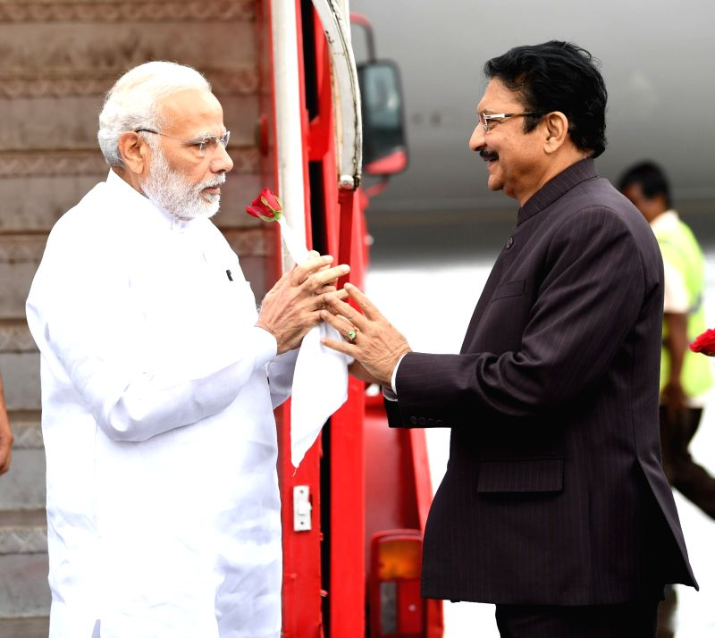 Prime Minister Narendra Modi being welcomed by the Governor of Maharashtra, C. Vidyasagar Rao, on his arrival, in Mumbai on Aug 11, 2018. - Narendra Modi and C. Vidyasagar Rao