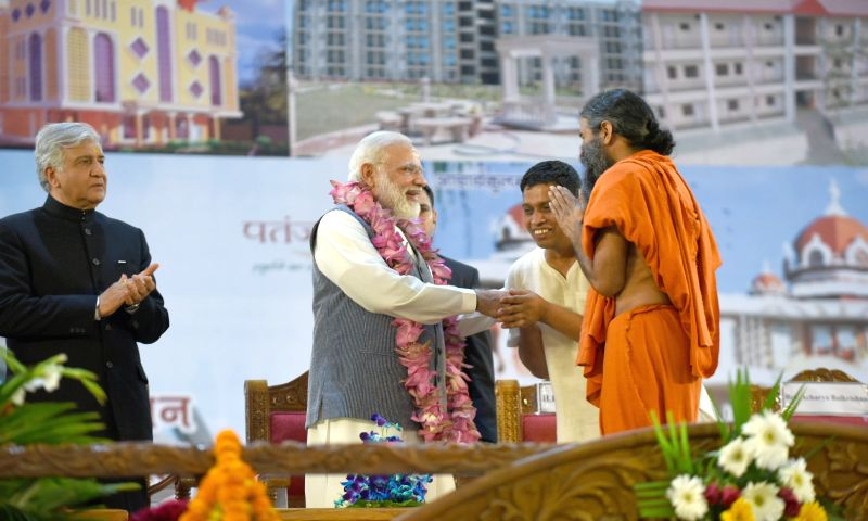 Prime Minister Narendra Modi being welcomed on the dais by Yoga Guru Ramdev at the inauguration of the Patanjali Research Institute in Haridwar on May 3, 2017. Also seen Uttarakhand ... - Narendra Modi