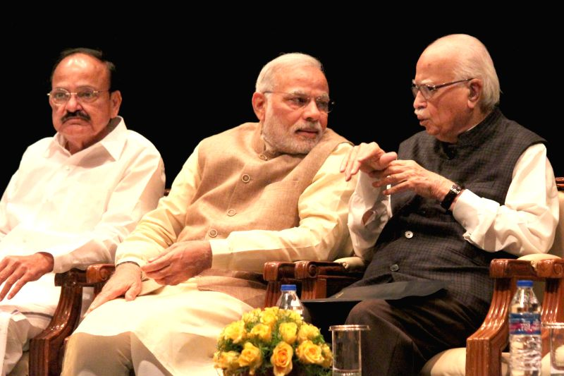 Prime Minister Narendra Modi, BJP MP L K Advani and the Union Minister for Urban Development, Housing and Urban Poverty Alleviation and Parliamentary Affairs M. Venkaiah during the BJP parliamentary ... - Narendra Modi and L K Advani