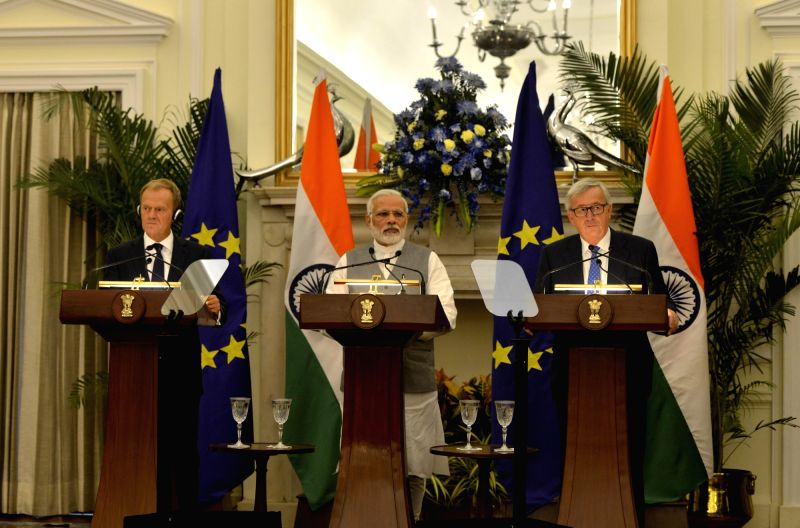 Prime Minister Narendra Modi (C), European Council President Donald Tusk (L) and European Commission President Jean-Claude Juncker during the joint press statement at Hyderabad House in ... - Narendra Modi
