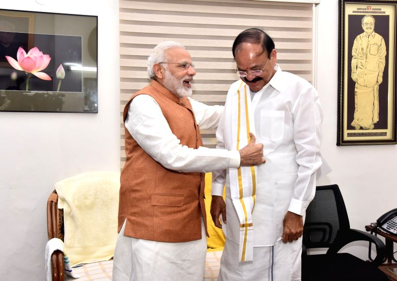 Prime Minister Narendra Modi congratulates M. Venkaiah Naidu on being elected India's 13th Vice President at his residence, in New Delhi on Aug 5, 2017. - Narendra Modi and M. Venkaiah Naidu