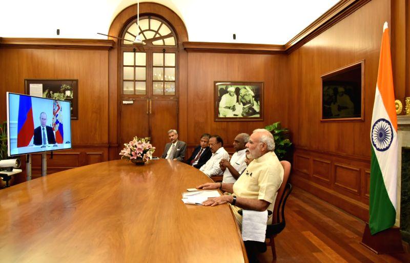 Prime Minister Narendra Modi dedicates Kudankulam nuclear power plant unit-1 to the Nation with the Russian President Vladimir Putin and Tamil Nadu Chief Minister J Jayalalithaa, through ... - Narendra Modi