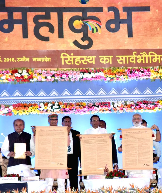 Prime Minister Narendra Modi dedicates Simhasth Declaration to world, at the International Convention on Universal Message of Simhastha, in Ujjain on May 14, 2016. Also seen the Sri Lankan ... - Narendra Modi, Narendra Singh Tomar and Shivraj Singh Chouhan
