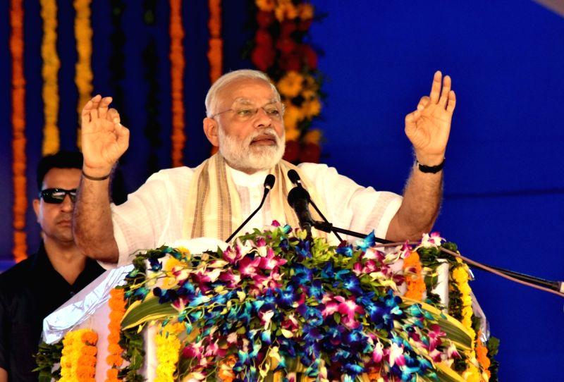 Prime Minister Narendra Modi delivers his address at the inauguration of the Kiran Multispeciality Hospital, in Surat, on April 17, 2017. - Narendra Modi
