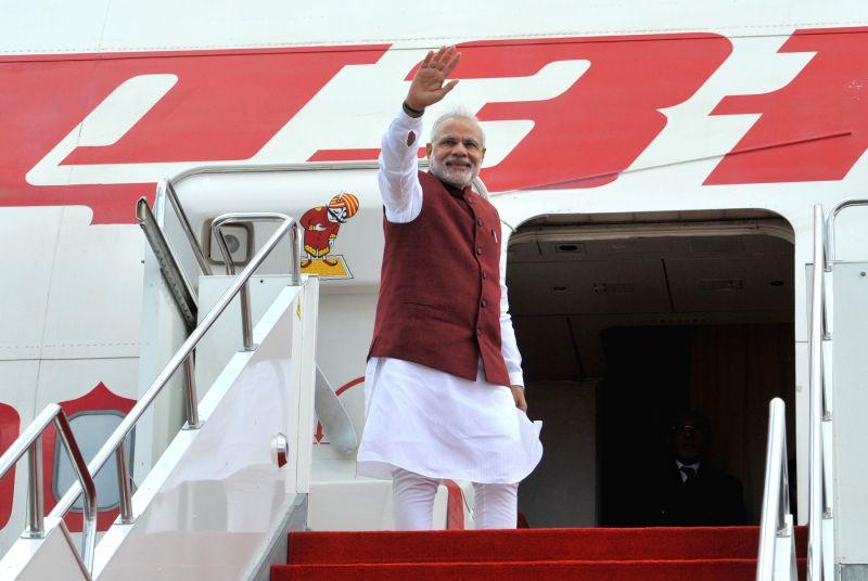 Prime Minister Narendra Modi departs from Kazakhstan for BRICS/SCO summits in the Russian city of Ufa, on July 8, 2015. - Narendra Modi