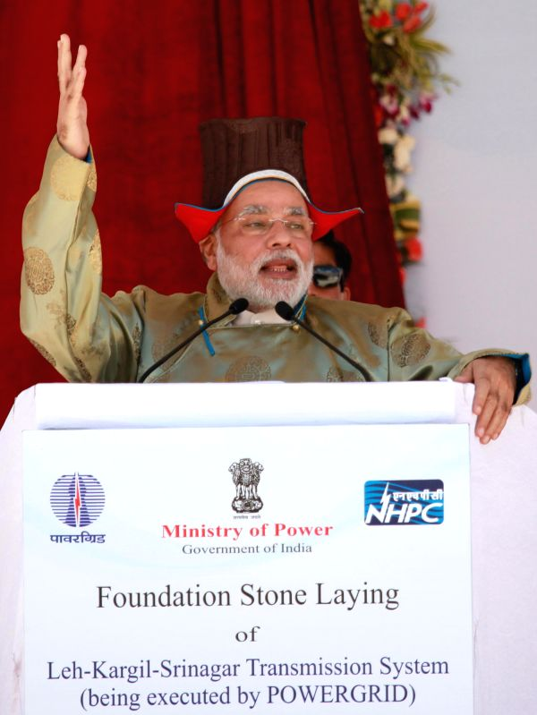 Prime Minister Narendra Modi, dressed in traditional Ladakhi gown and headgear addresses during foundation stone laying programme of the Rs.1,700 crore, 330 km long Srinagar-Leh transmission line ... - Narendra Modi