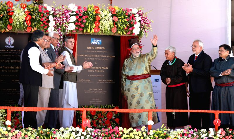 Prime Minister Narendra Modi, dressed in traditional Ladakhi gown and headgear with Jammu and Kashmir Chief Minister Omar Abdullah during inauguration of 45 megawatt Nimoo-Bazgo hydro-electric ... - Narendra Modi
