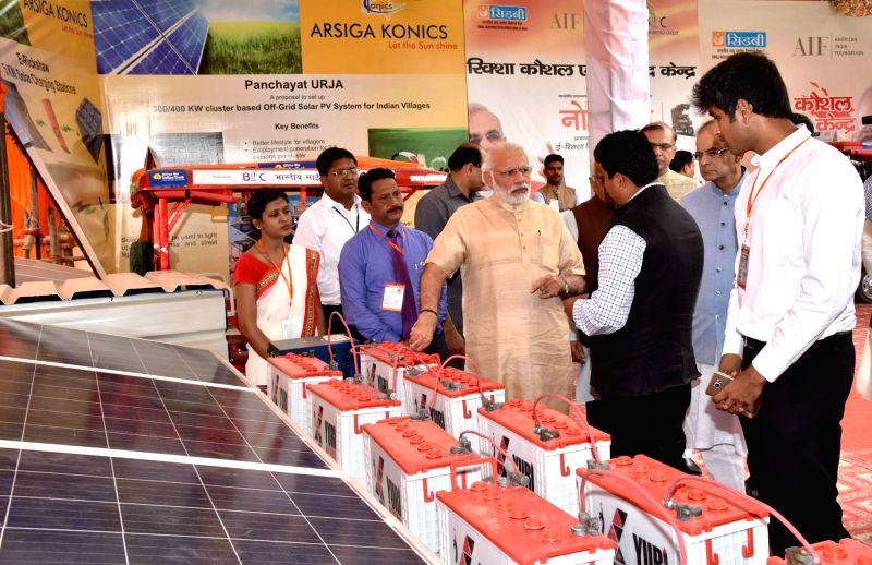 "Prime Minister Narendra Modi during a programme organised to launch ""Stand Up India"" programme, in Noida, Uttar Pradesh on April 5, 2016. - Narendra Modi"