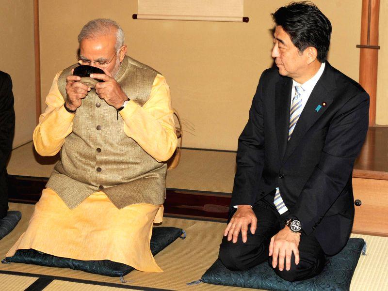 Prime Minister Narendra Modi during a Tea ceremony hosted by Japanese Prime Minister Shinzo Abe in Tokyo, Japan on Sep 1, 2014. - Narendra Modi