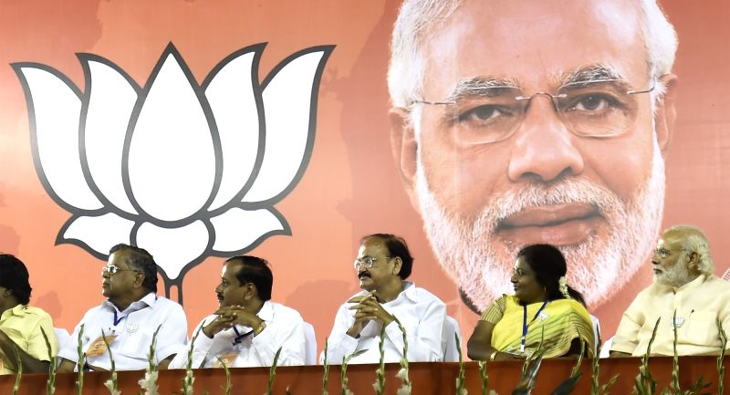 Prime Minister Narendra Modi during an election campaign rally ahead of the Tamil Nadu Assembly elections, in Chennai on May 6, 2016. Also seen Union Minister for Urban Development, Housing ... - Narendra Modi and M Venkaiah Naidu