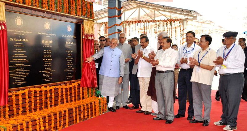 Prime Minister Narendra Modi during opening ceremony of the newly constructed railway line between Katra-Udhampur Section in Katra of Jammu and Kashmir on July 04, 2014. Also seen Jammu and Kashmir .. - Narendra Modi, Manoj Sinha, Jitendra Singh and Board Arunendra Kumar