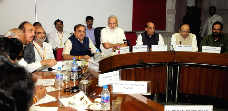 Prime Minister Narendra Modi during the All Party meeting in New Delhi on July 17, 2016. Also seen Union Ministers Rajnath Singh, Arun Jaitley, Mukhtar Abbas Naqvi and Ananth Kumar. - Narendra Modi, Ministers Rajnath Singh, Arun Jaitley, Mukhtar Abbas Naqvi and Ananth Kumar
