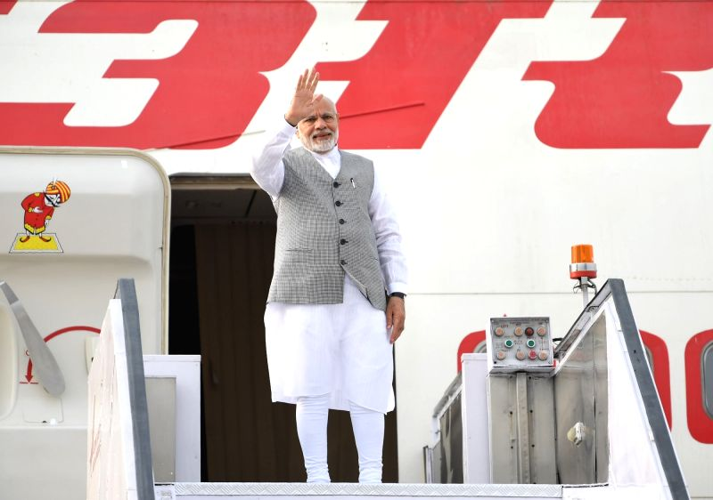 Prime Minister Narendra Modi emplanes for Qingdao, China to attend the annual SCO Summit, in New Delhi on June 09, 2018. - Narendra Modi