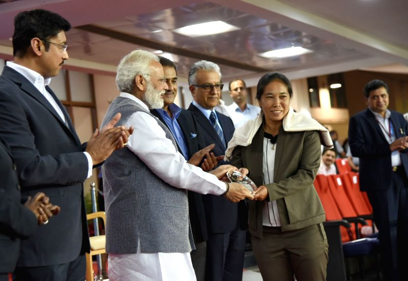 Prime Minister Narendra Modi felicitates Indian football legends, at the 2017 FIFA U-17 World Cup match, in New Delhi on Oct 6, 2017. Also seen MoS Sports Col. Rajyavardhan Singh Rathore. - Narendra Modi and Rajyavardhan Singh Rathore