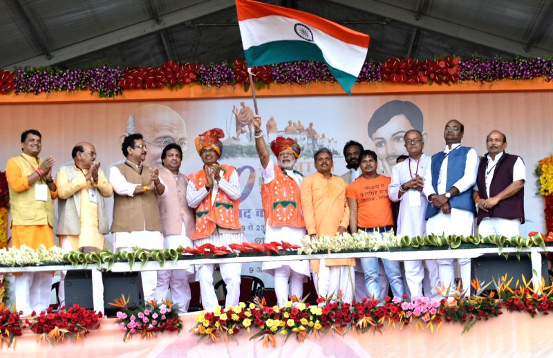 Prime Minister Narendra Modi flaggs off the Tiranga Yatra to mark the launch of 70th Freedom Year Celebrations, in Bhabra village, Alirajpur district, Madhya Pradesh on Aug 9, 2016. Also ... - Narendra Modi and Shivraj Singh Chouhan