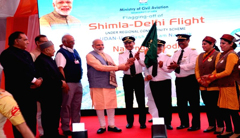 Prime Minister Narendra Modi flags-off first Shimla-Delhi flight under UDAN - Ude Desh ka Aam Nagrik scheme at Jubbarhatti airport in Shimla on April 27, 2017. - Narendra Modi