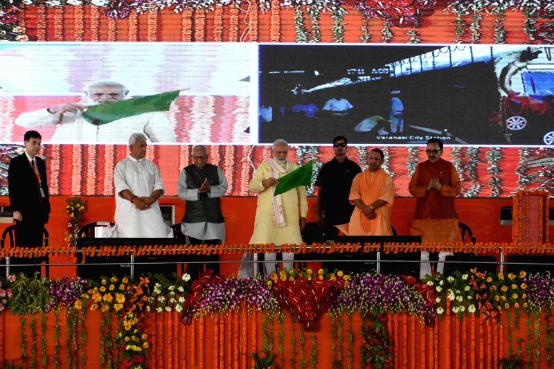 Prime minister Narendra Modi flags off the Varanasi-Ballia EMU train along with Uttar Pradesh Governor Ram Naik, Chief Minister Yogi Adityanath, Union MoS Communications Manoj Sinmha and ... - Narendra Modi and Mahendra Nath Pandey