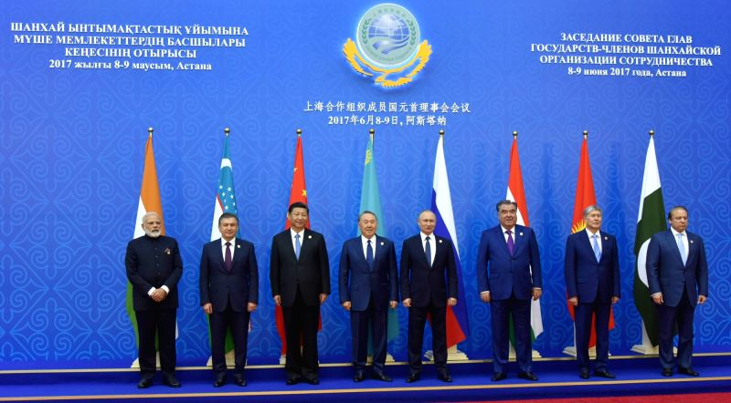 Prime Minister Narendra Modi in a group photograph of the SCO Member States' HODs after inclusion of new Member States at the Shanghai Cooperation Organisation (SCO) Summit in Astana, ... - Narendra Modi