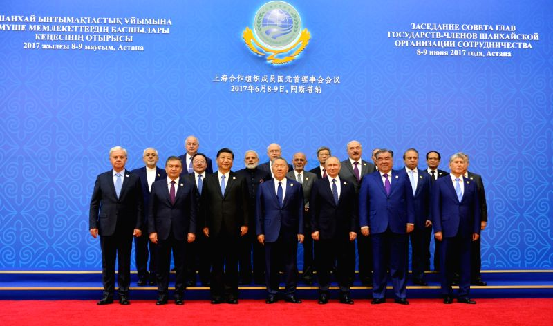 Prime Minister Narendra Modi in a group photograph of the HODs participating in extended format meeting at the Shanghai Cooperation Organisation (SCO) Summit in Astana, Kazakhstan on June 9, ... - Narendra Modi