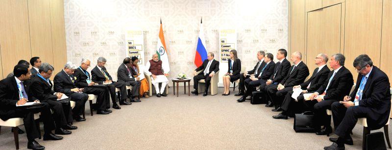 Prime Minister Narendra Modi in bilateral meeting with the Russian President Vladimir Putin, at Congress Hall, in Ufa, Russia on July 8, 2015. - Narendra Modi