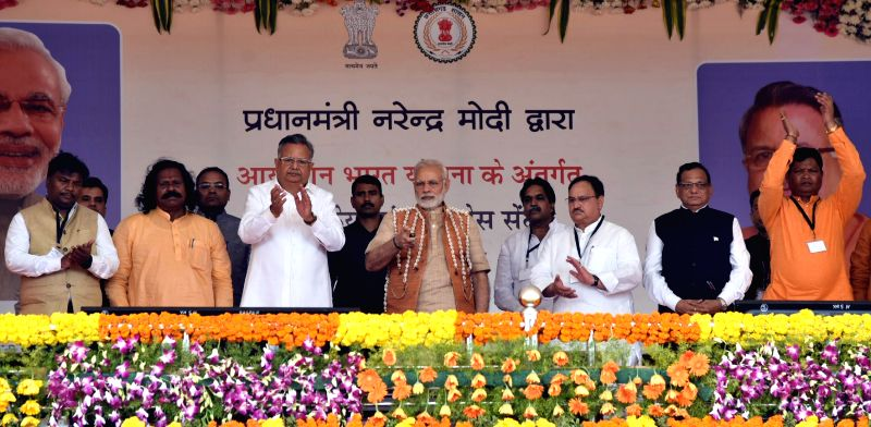 Prime Minister Narendra Modi inaugurates Health and Wellness Centre to mark the launch of Ayushman Bharat Yojana, in Chattisgarh's Bijapur on April 14, 2018. Also seen Chhattisgarh Chief ... - Narendra Modi and Raman Singh
