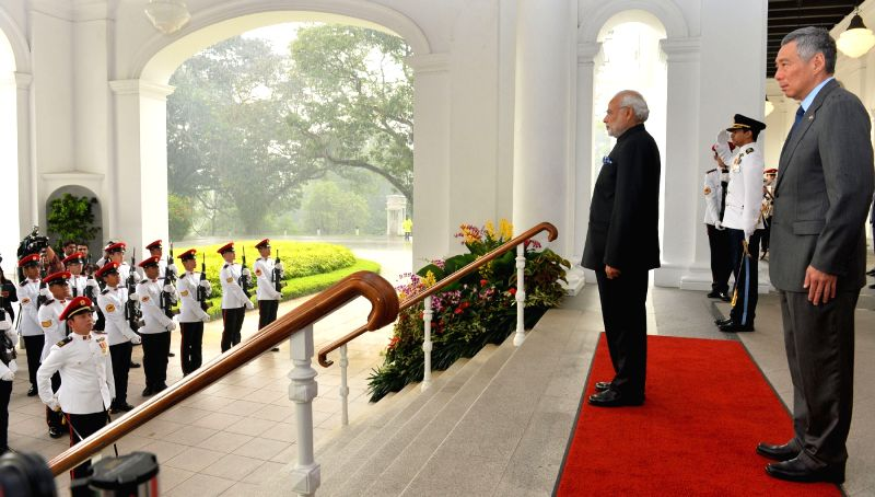Prime Minister Narendra Modi inspects the Guard of Honour at the ceremonial welcome, in Istana, Singapore on Nov 24, 2015. Also seen Prime Minister of Singapore Lee Hsien Loong. - Narendra Modi