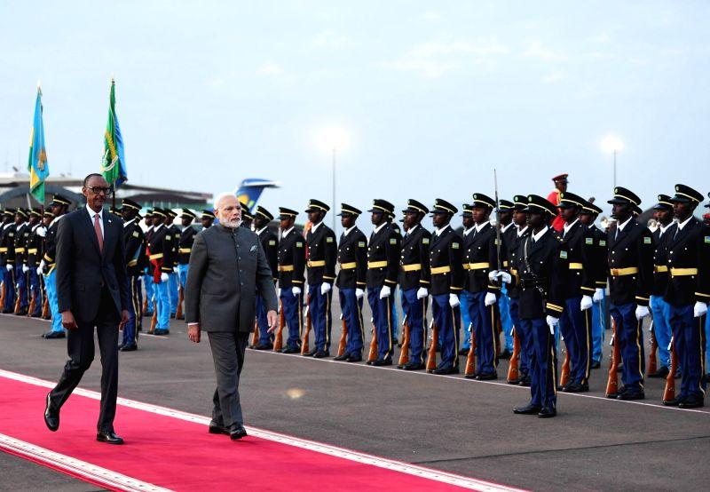 Prime Minister Narendra Modi inspects the Guard of Honour accompanied by Rwanda President Paul Kagame, on his arrival at Kigali International Airport in Rwanda on July 23, 2018. - Narendra Modi