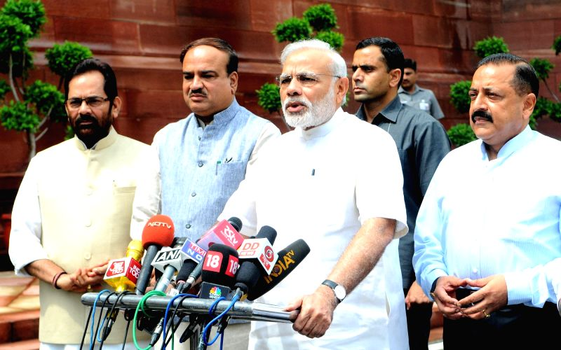 Prime Minister Narendra Modi interacting with the media at the start of Monsoon Session of Parliament, in New Delhi on July 18, 2016. The Union Minister for Chemicals & Fertilizers and ... - Narendra Modi, Affairs Ananth Kumar and Jitendra Singh
