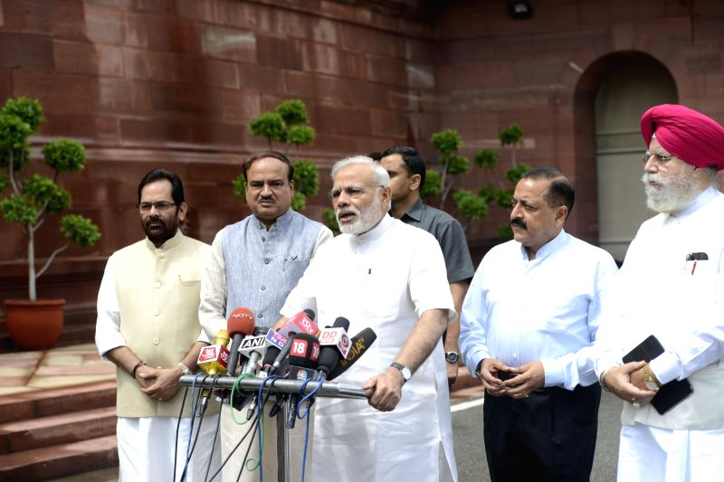 Prime Minister Narendra Modi interacting with the media before the start of Monsoon Session of Parliament in New Delhi on July 18, 2016. Also seen The Union Minister for Chemicals & ... - Narendra Modi, Ananth Kumar and Jitendra Singh