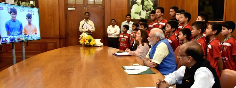 Prime Minister Narendra Modi interacting with the children at the launch of the Reliance Foundation Youth Sports, through video conferencing, in New Delhi on July 23, 2016. The Minister of ... - Narendra Modi
