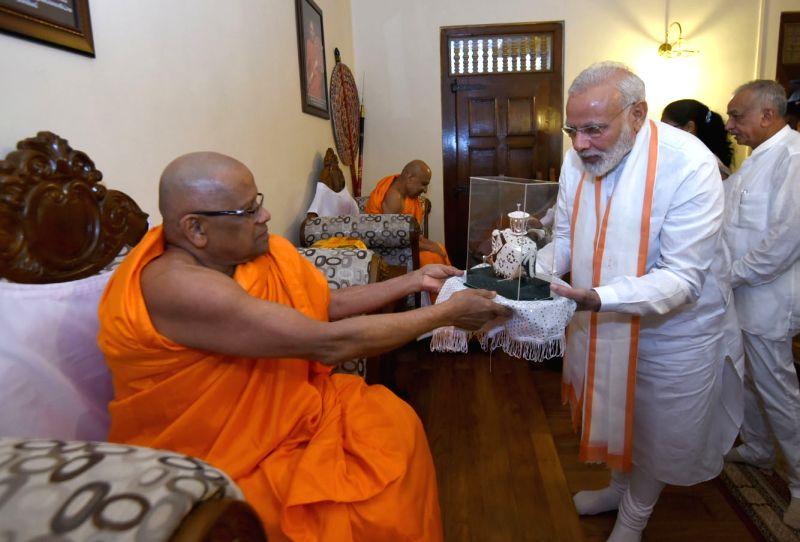 Prime Minister Narendra Modi interacts with Mahanayakas at Sri Dalada Maligawa Temple (The Temple of Sacred Tooth Relic) in Kandy, Sri Lanka on May 12, 2017. - Narendra Modi