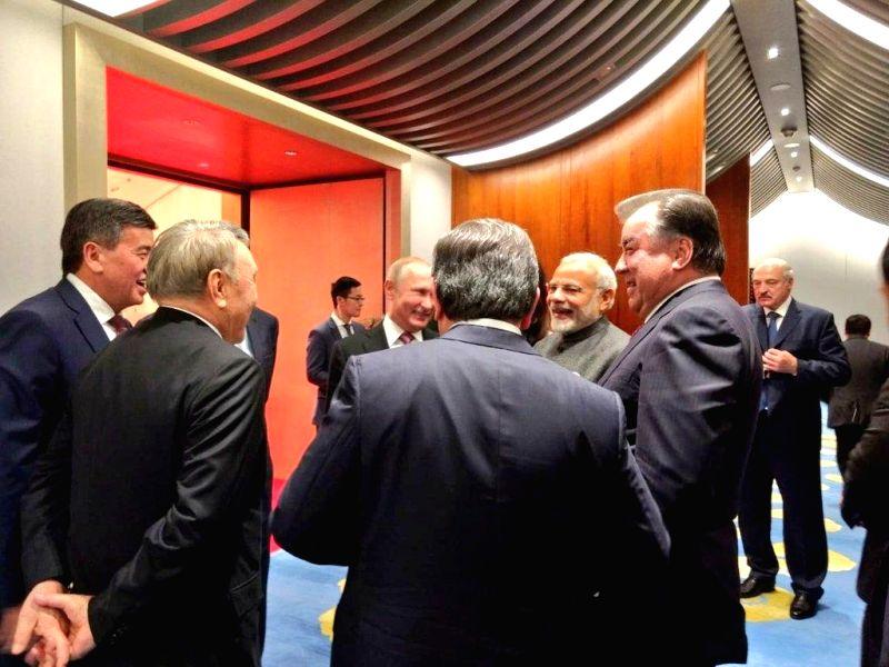 Prime Minister Narendra Modi interacts with Uzbekistan President Shavkat Mirziyoyev, Russian President Vladimir Putin and other leaders of Shanghai Cooperation Organisation (SCO) member ... - Narendra Modi