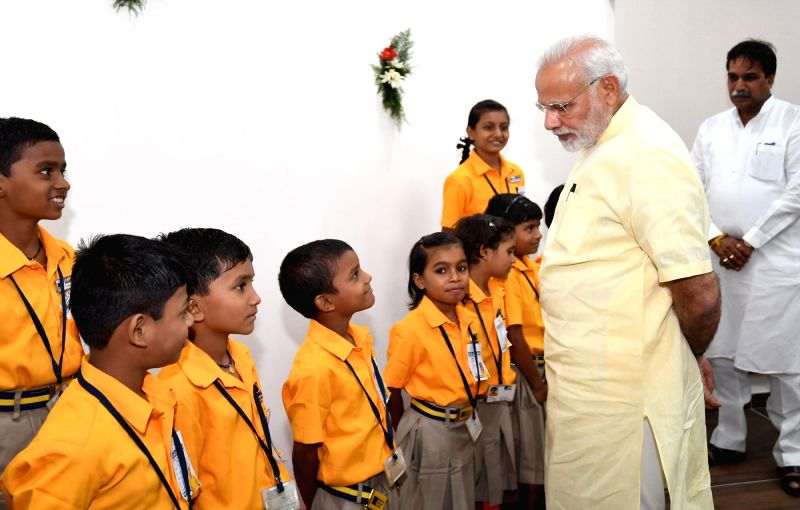 Prime Minister Narendra Modi interacts with school children after inaugurating the Integrated Command and Control Centre, in Raipur on June 14, 2018. - Narendra Modi