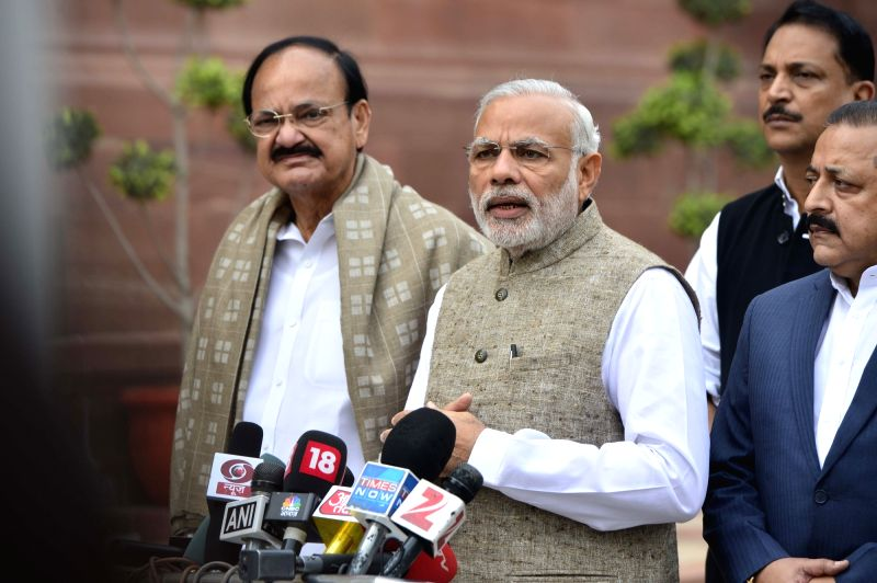 Prime Minister Narendra Modi interacts with media in the beginning of the Winter Session of Parliament - 2015, in New Delhi on Nov 26, 2015. Also seen Union Minister for Urban Development, Housing ... - Narendra Modi, M. Venkaiah Naidu and Jitendra Singh