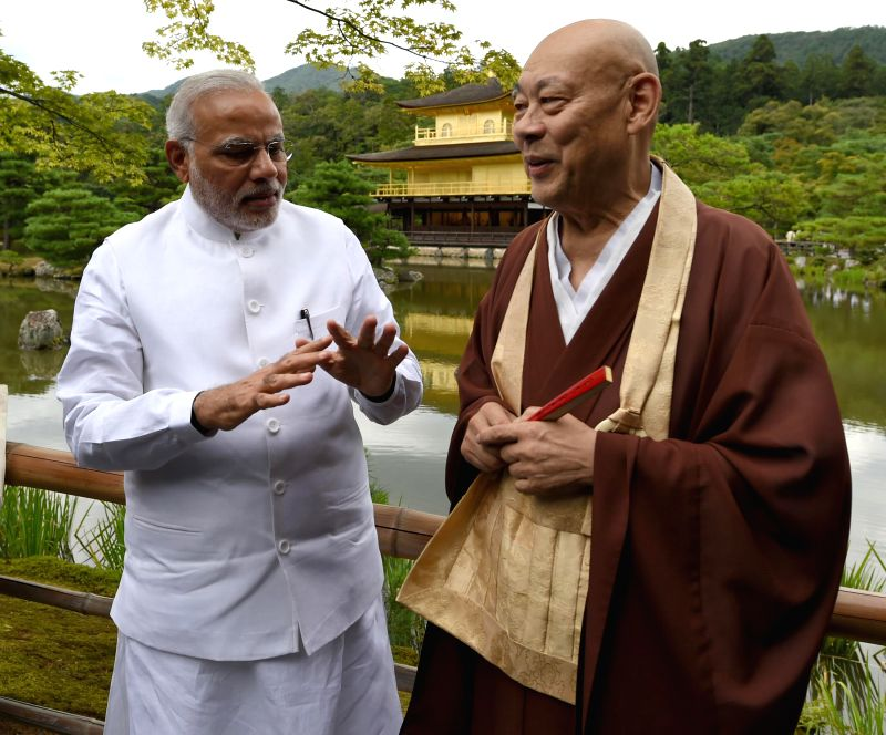 Prime Minister Narendra Modi interacts with the head priest of the Kinkaku-ji (Golden Pavilion) Temple during his visit to the temple in Kyoto, Japan on August 31, 2014. - Narendra Modi