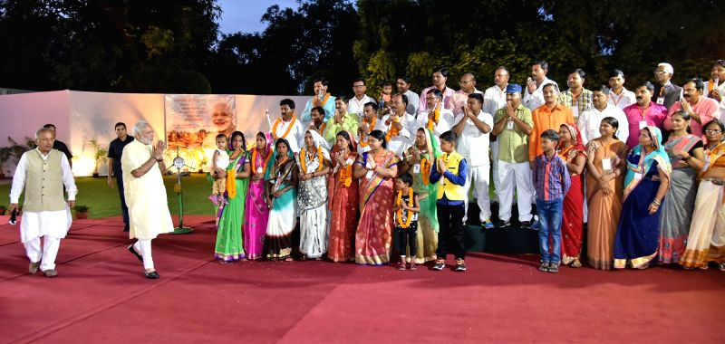 Prime Minister Narendra Modi interacts with the Village Pradhans from Varanasi Parliamentary Constituency, in New Delhi on Aug 9, 2016. - Narendra Modi