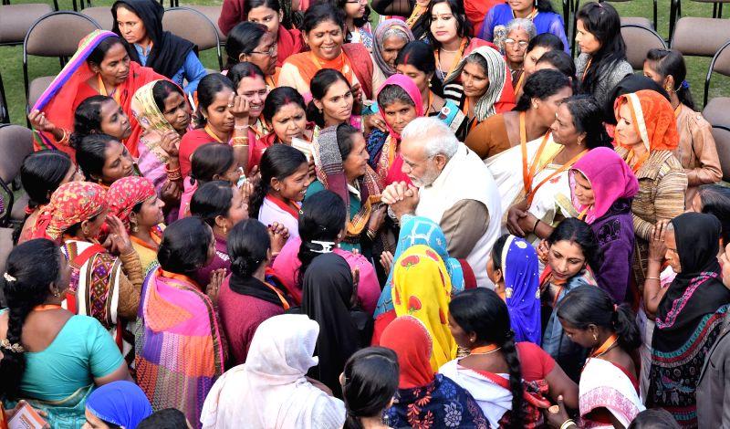 Prime Minister Narendra Modi interacts with the beneficiaries of the Pradhan Mantri Ujjwala Yojana in New Delhi on Feb 13, 2018. - Narendra Modi