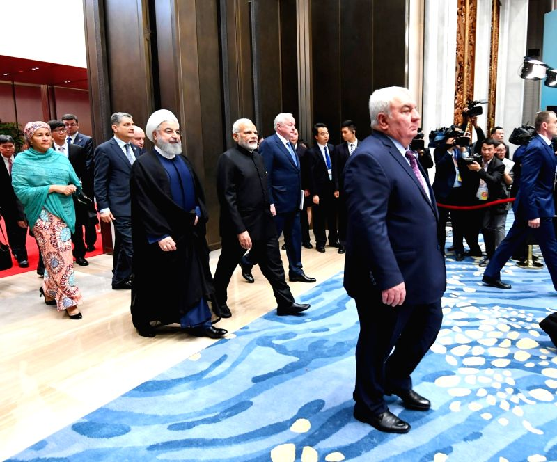 Prime Minister Narendra Modi, Iranian President Hassan Rouhani and Tajikistan President Emomali Rahmon arrive to attend the Plenary Session of the Shanghai Cooperation Organisation (SCO) ... - Narendra Modi and Hassan Rouhani