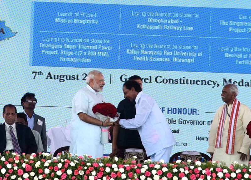 Prime Minister Narendra Modi launches Mission Bhagiratha in Medak district of Telangana on August 7, 2016. Also seen Union Minister for Urban Development, Housing and Urban Poverty Alleviation ... - Narendra Modi, M. Venkaiah Naidu and K. Chandrasekhar Rao