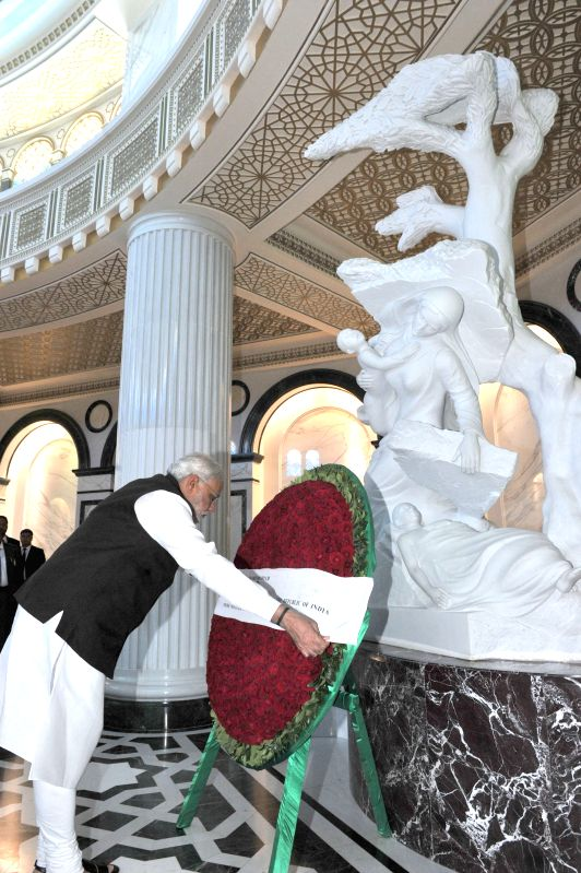 Prime Minister Narendra Modi lays a wreath at the Mausoleum of the First President of Turkmenistan, in Ashgabat, Turkmenistan on July 11, 2015. - Narendra Modi
