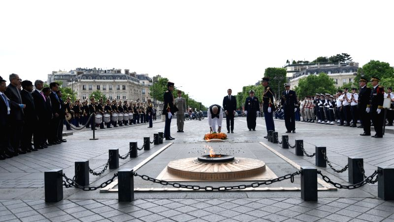 Prime Minister Narendra Modi lays wreath at Arc de Triomphe in Paris on June 3, 2017. Also seen French President Emmanuel Macron. - Narendra Modi