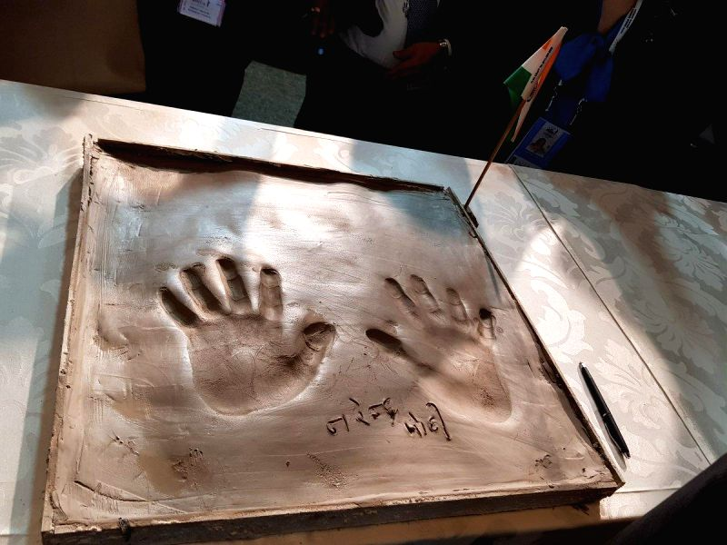 Prime Minister Narendra Modi leaves his hand impression on clay, for a symbolic demonstration of our connect to the Cradle of Humankind in Maropeng, South Africa on July 26, 2018. - Narendra Modi